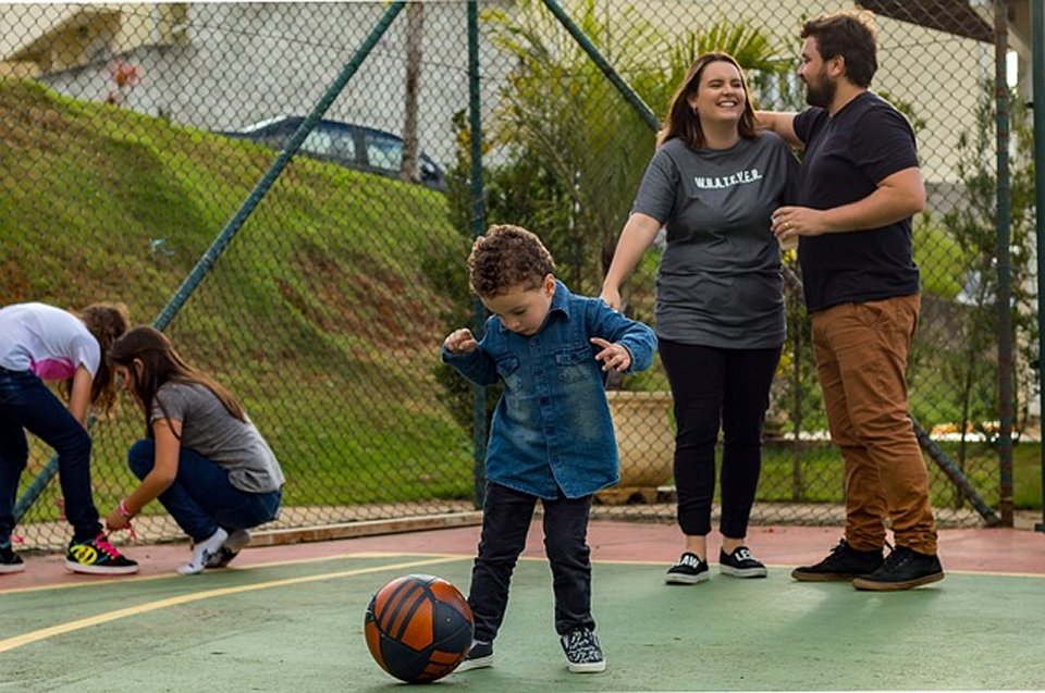 With increasingly demanding and sedentary lifestyles, the impact on the health of American adults and children is beginning to show. child playing kickball with parents
