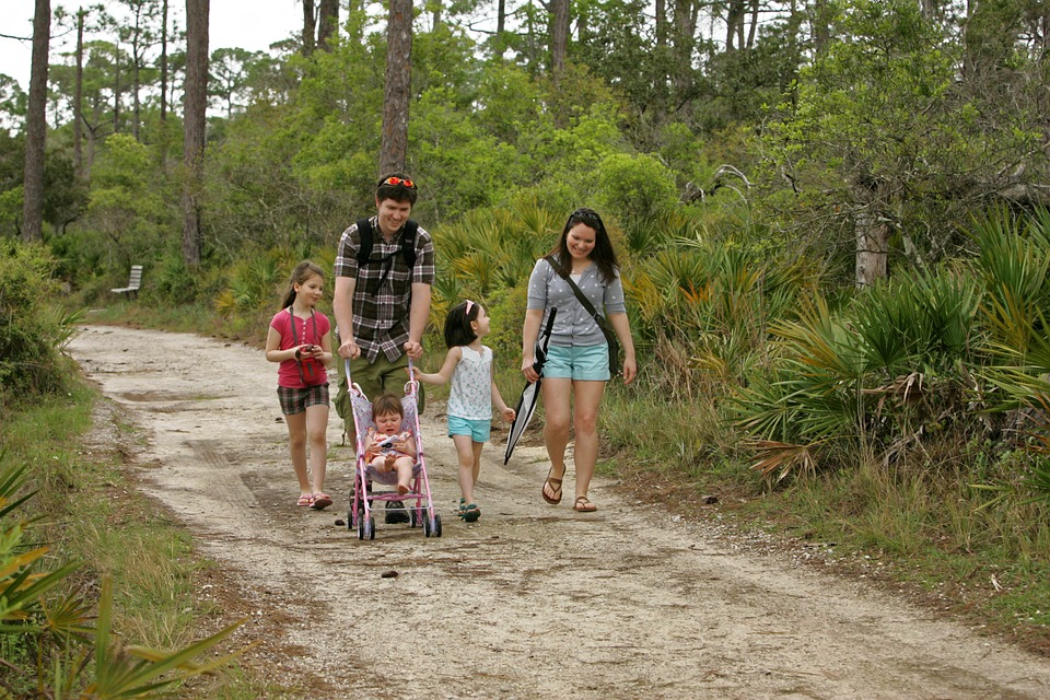 You hear a lot about how kids and adults alike are overscheduled and overextended. Family walking