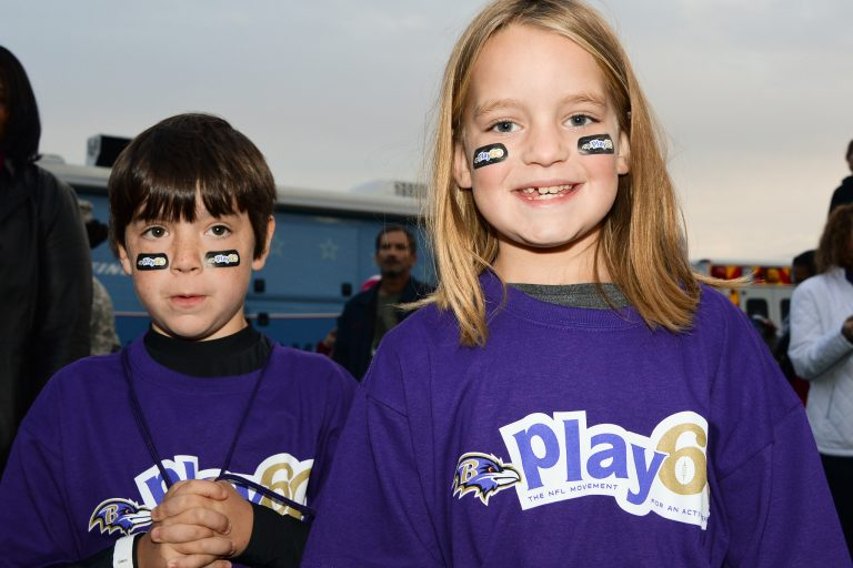 Two kids smiling in a NFL Play 60 event.