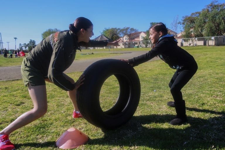 mother and daughter competing in a family fitness challenge