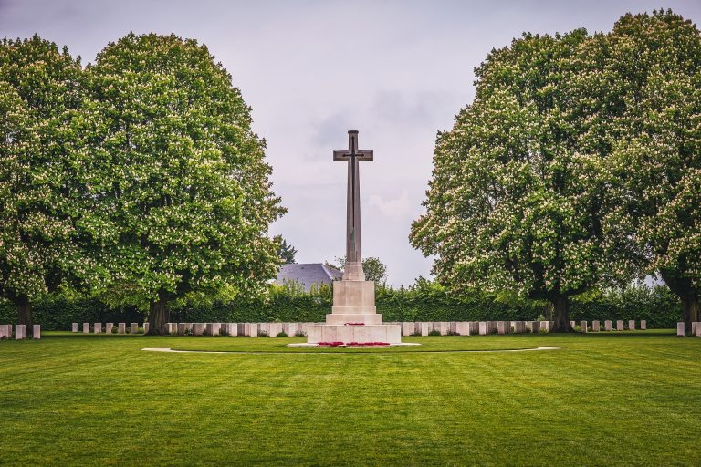 Large cross statue on lawn memorial day