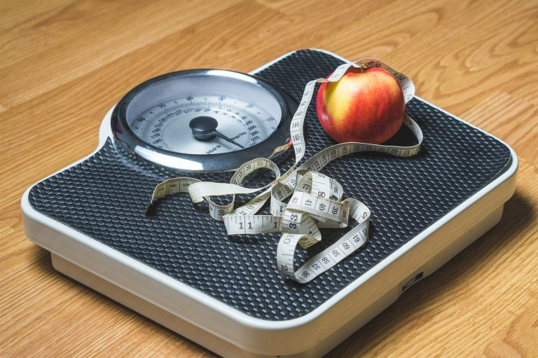 fitness challenge ideas: scale with apple and a measuring tape