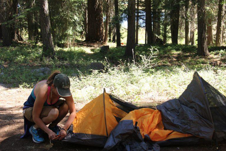 primitive camping. Women setting camp
