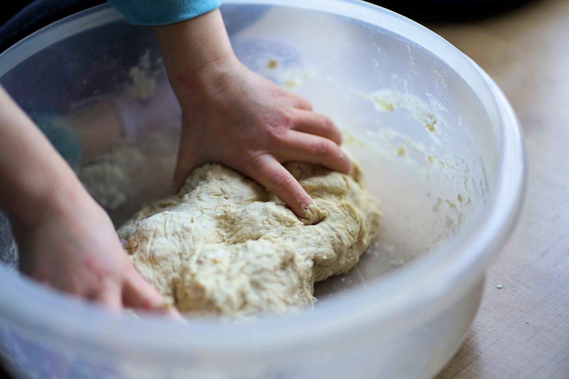 person making a dough