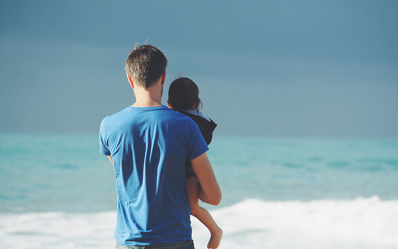 father and daughter on a beach