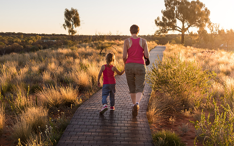 mom walking with her daughter
