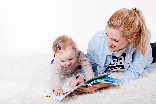 toddler and her mom doing the Kiwico activity together